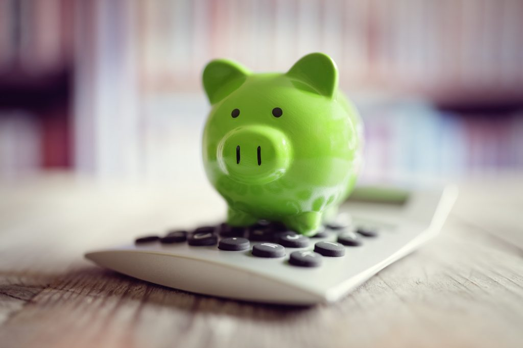 Piggy bank with calculator - Citadel Financial Wealth Group -life insurance-life insurance for children - Critical Illness Insurance- Disability Insurance - Group Insurance Plans - Group Insurance - SME - Guaranteed Issue Life Insurance - No Medcial Life Insurance - Non Medical Life Insurance - Life Annuity - Life Insurance - Whole Life Insurance - Term Life Insurance -Mortgage Insurance - Mortgage life insurance - Life Insurance For Business Owners - Overhead expense Insurance - Long Term Care Insurance - Personal Banking - Open Bank Account - Personal Health Insurance - health Insurance - Travel Insurance -Health & dental insurance- health and dental insurance - RESP - Segregated Funds - Senior Life Insurance - Final Expenses - Final Expense Insurance - Final Expenses Insurance - Universal Life Insurance - Visitor To Canada Super Visa Insurance