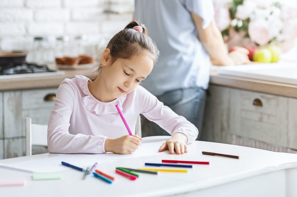 Pretty little girl busy with drawing at kitchen table - Citadel Financial Wealth Group -life insurance-life insurance for children - Critical Illness Insurance- Disability Insurance - Group Insurance Plans - Group Insurance - SME - Guaranteed Issue Life Insurance - No Medcial Life Insurance - Non Medical Life Insurance - Life Annuity - Life Insurance - Whole Life Insurance - Term Life Insurance -Mortgage Insurance - Mortgage life insurance - Life Insurance For Business Owners - Overhead expense Insurance - Long Term Care Insurance - Personal Banking - Open Bank Account - Personal Health Insurance - health Insurance - Travel Insurance -Health & dental insurance- health and dental insurance - RESP - Segregated Funds - Senior Life Insurance - Final Expenses - Final Expense Insurance - Final Expenses Insurance - Universal Life Insurance - Visitor To Canada Super Visa Insurance